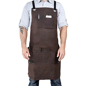 man wearing a waxed canvas work apron