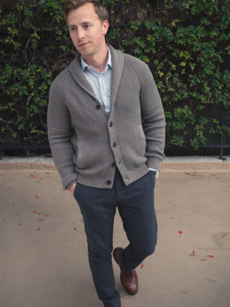 man wearing a grey buttoned cardigan for work style from primer magazine