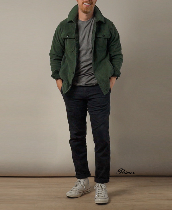 men's casual outfit idea with green fleece sweater jacket and blue chinos with converse sneakers