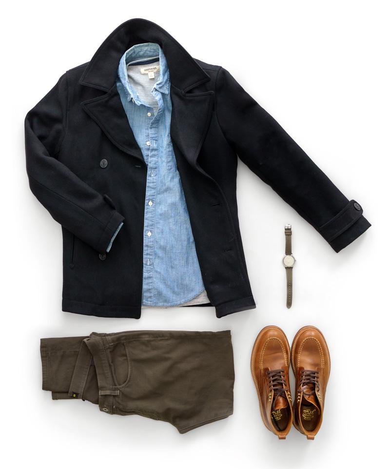 flatlay de roupa masculina com casaco de ervilha, camisa de cambraia, calça de pederneira e tinder 365, relógio timex x todd snyder, botas jcrew kenton