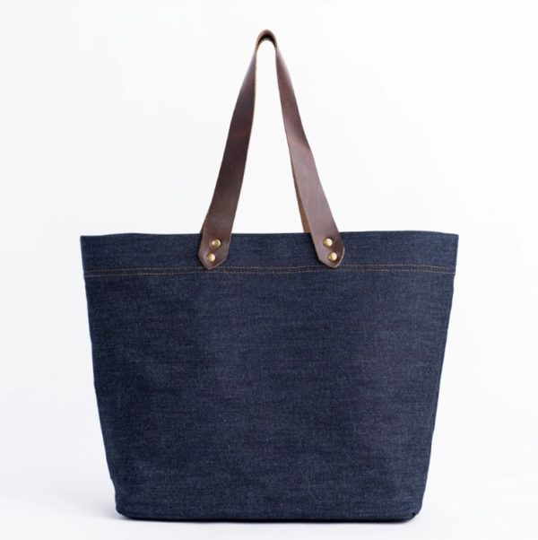 denim tote bag with brown leather handles