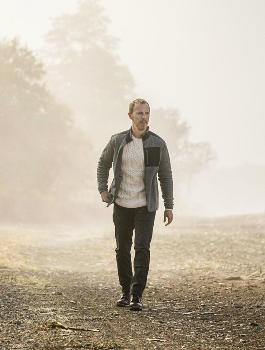 man wearing a fleece jacket and denim jeans