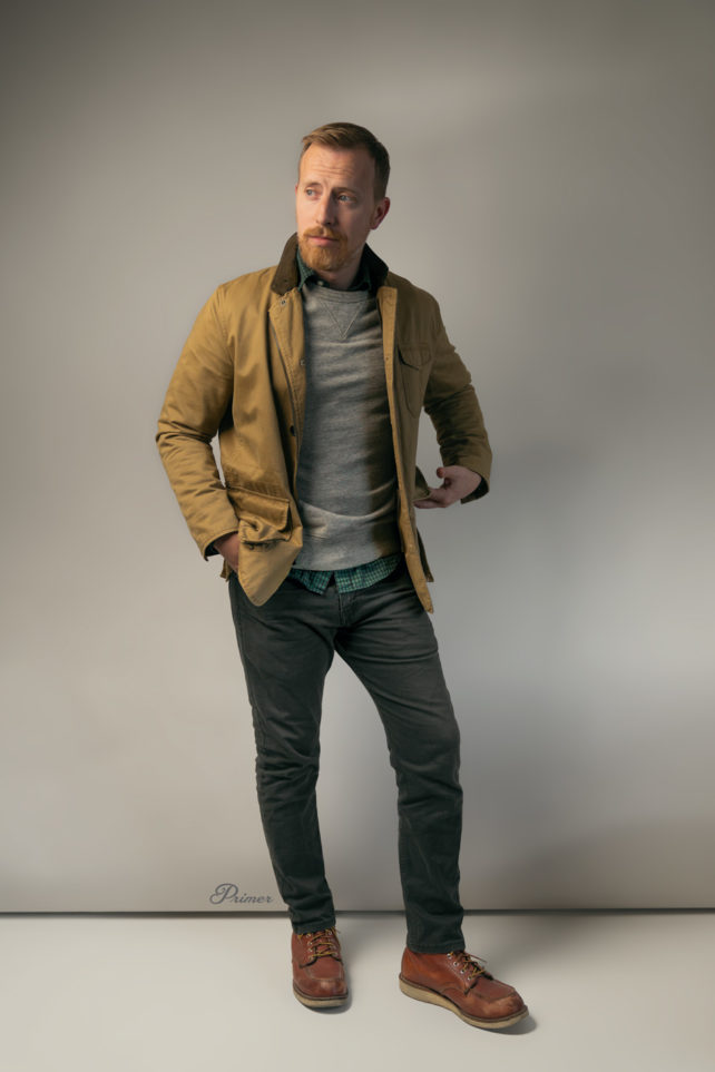 rugged outfit inspiration: field jacket, gray sweatshirt, plaid shirt, gray jeans, red wings