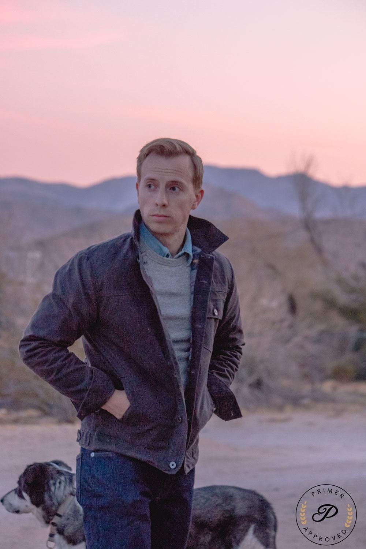 man wearing a flint and tinder waxed canvas trucker jacket