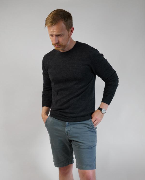 black merino wool sweater with blue shorts