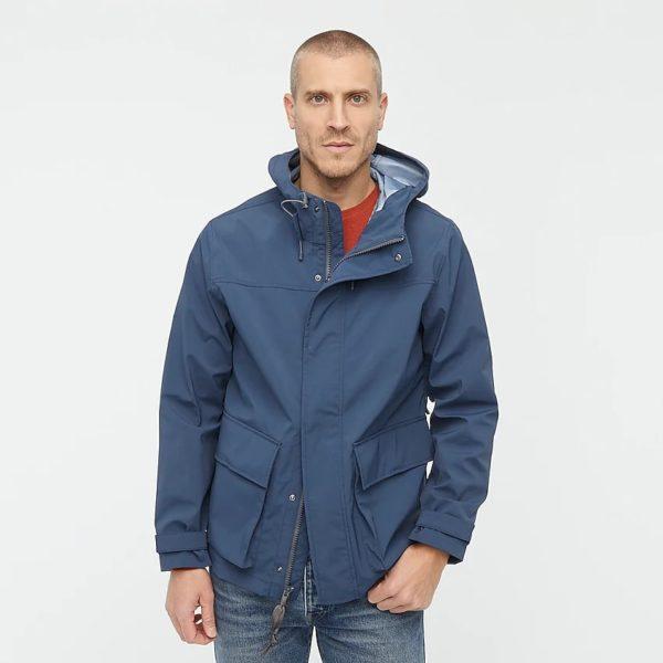 man wearing a blue raincoat