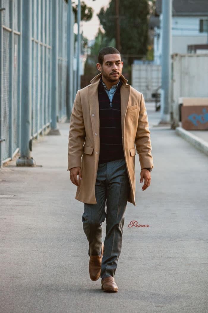 man wearing a brown overcoat jacket