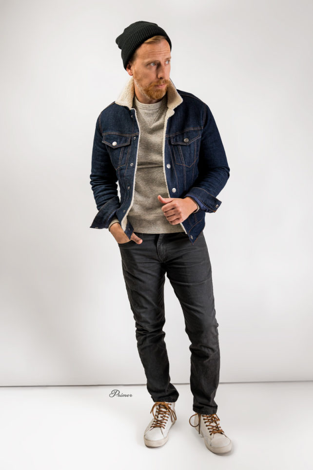 mens outfit with sherpa denim jacket, gray sweatshirt, gray jeans, white leather high top sneakers