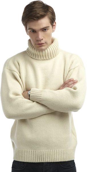 man wearing a cream colored merino wool turtleneck sweater