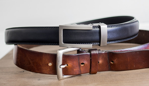 Anson belt next to a belt with worn holes