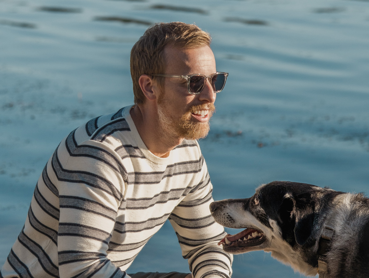 men clear sunglasses on man with dog
