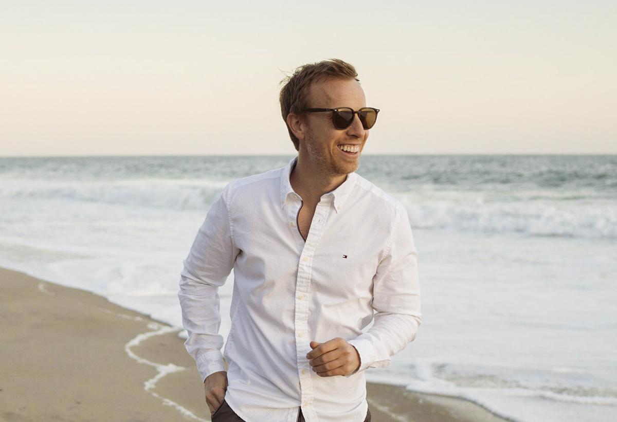 man on beach wearing ray-ban sunglasses