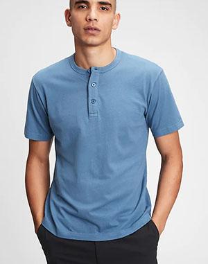 man wearing a blue short sleeve henley shirt from gap