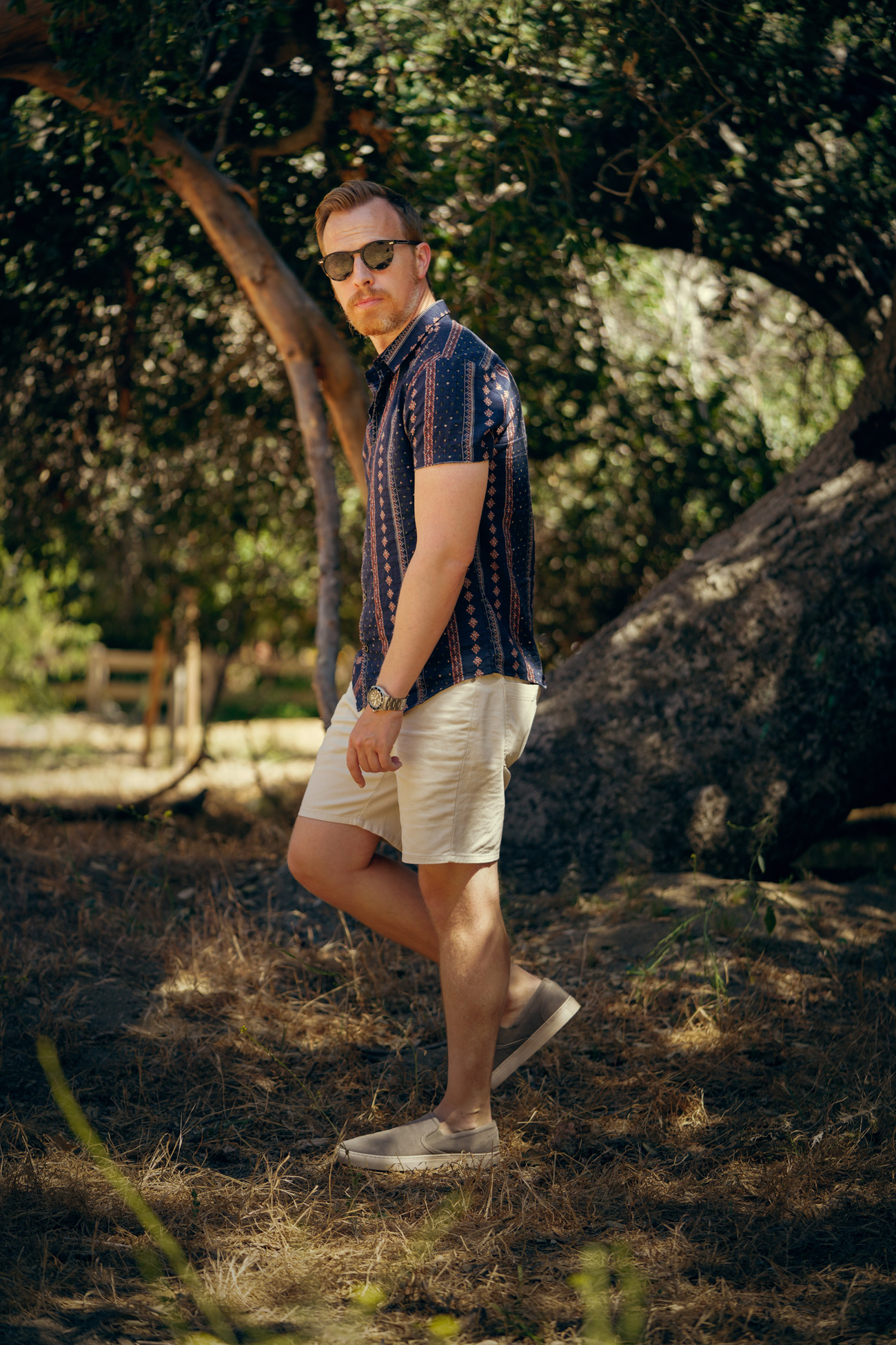 short sleeve floral shirt with white shorts and sneakers - mens summer outfit idea