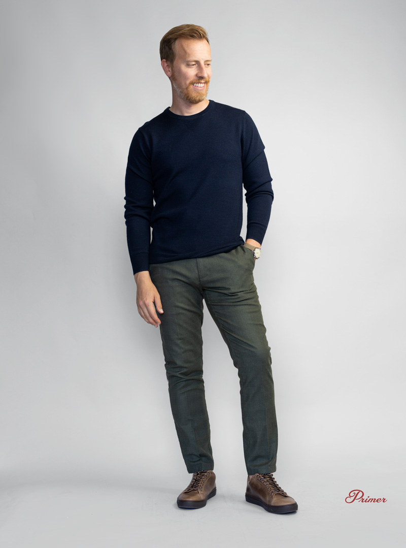 mens outfit with blue sweater green pants and brown sneakers