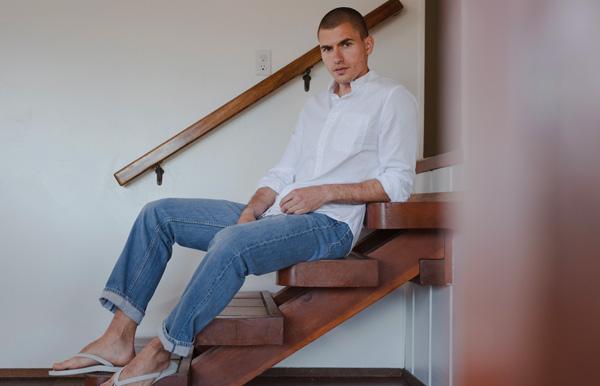 man wearing save khaki clothing brand shirt and jeans