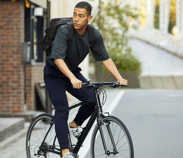 man wearing Uniqlo clothing while riding bicycle