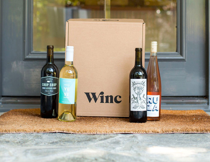 winc wine subscription box with 4 wine bottles