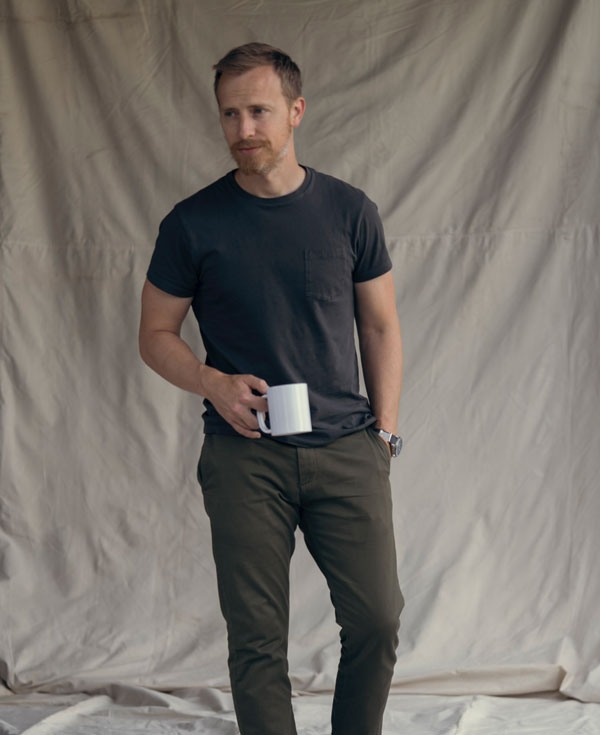 Andrew Snavely wearing black pocket t-shirt with green olive chinos in summer