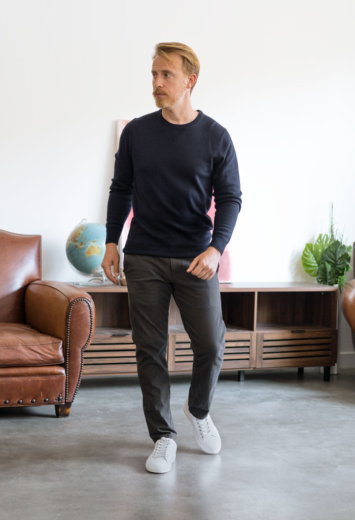 navy sweater with grey dockers chinos and white sneakers