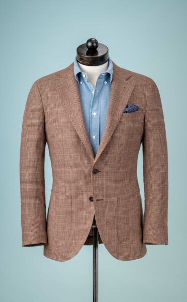 brown suit jacket and blue button up shirt