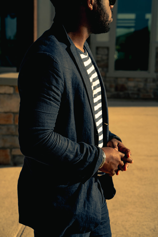 man in dressed down suit with t-shirt