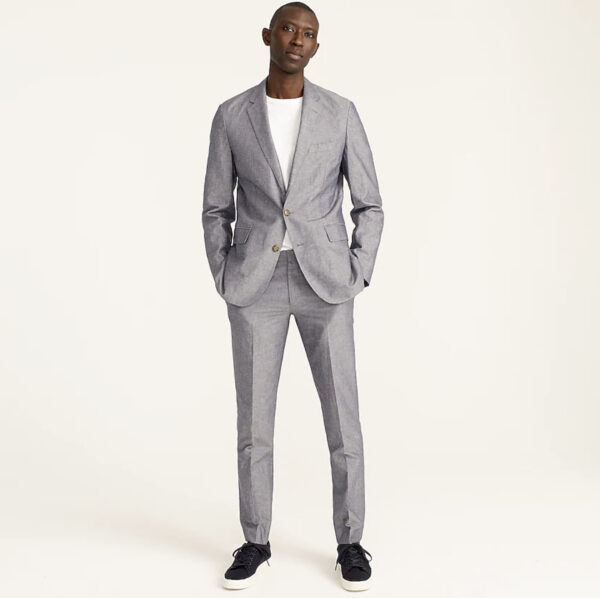 man wearing a grey suit jacket and grey suit pants