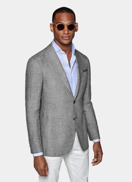 man wearing a light grey suit jacket