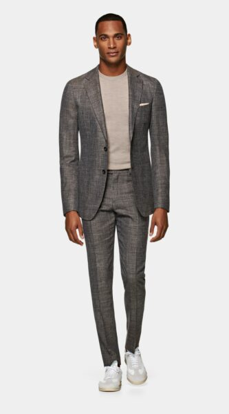 man wearing brown suit jacket and brown suit pants