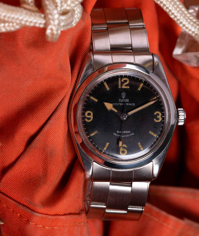 watch with silver metal strap and black face