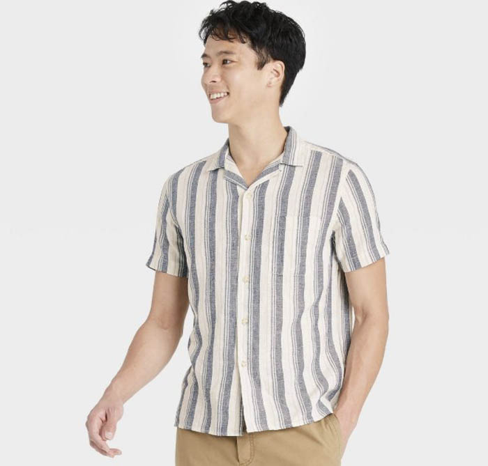 man wearing a blue and white striped short sleeve button down camp collar shirt