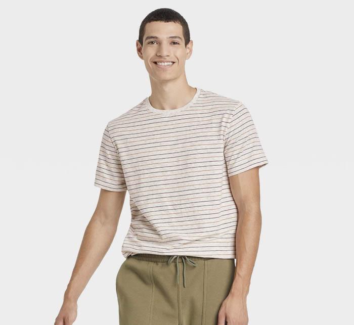 man wearing a striped short sleeve crewneck shirt