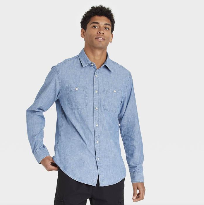 man wearing a light blue long sleeve button down shirt