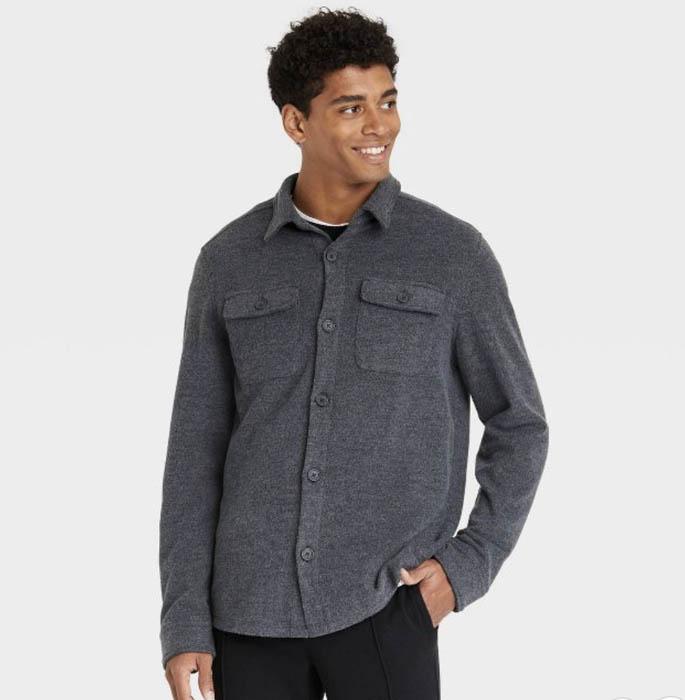 man wearing a black canvas chore shirt jacket