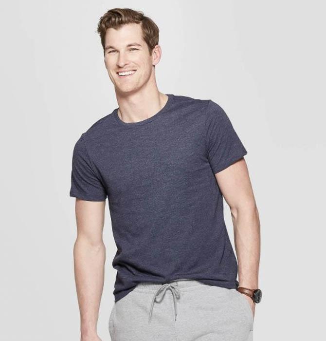 man wearing a blue short sleeve crew neck shirt