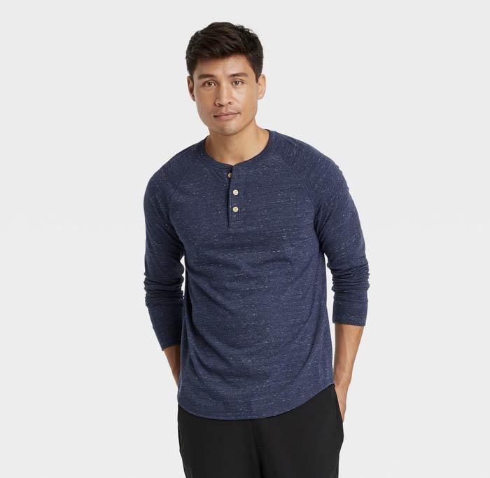 man wearing a dark blue long sleeve henley shirt