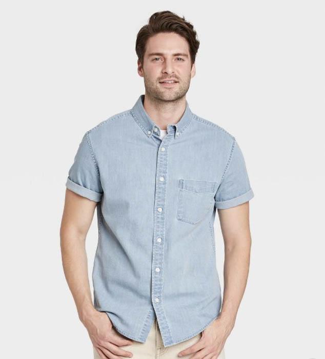 man wearing a denim short sleeve button down shirt