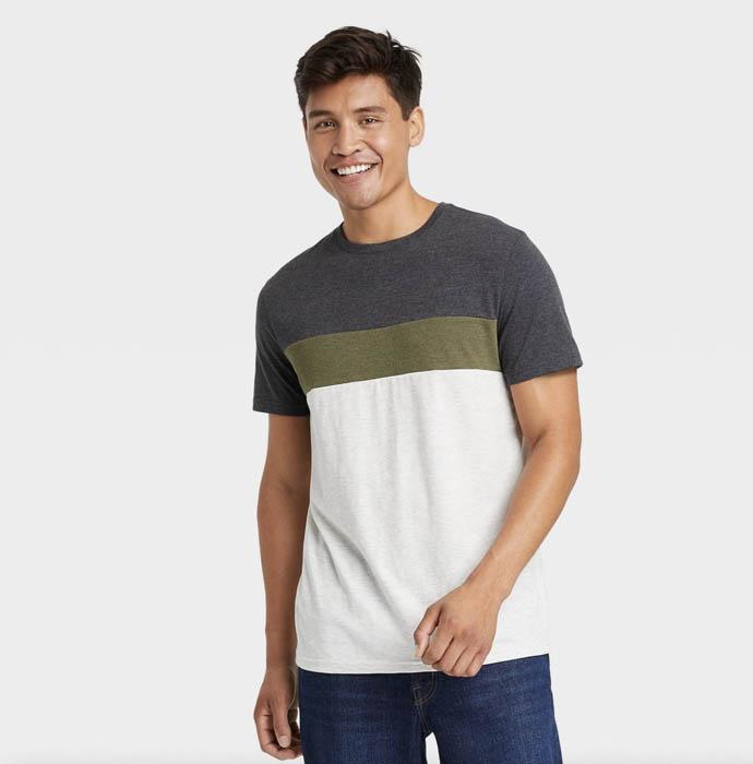 man wearing a color block short sleeve crewneck shirt