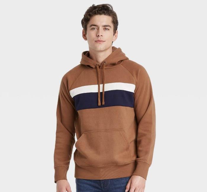 man wearing a brown cedar hooded sweatshirt