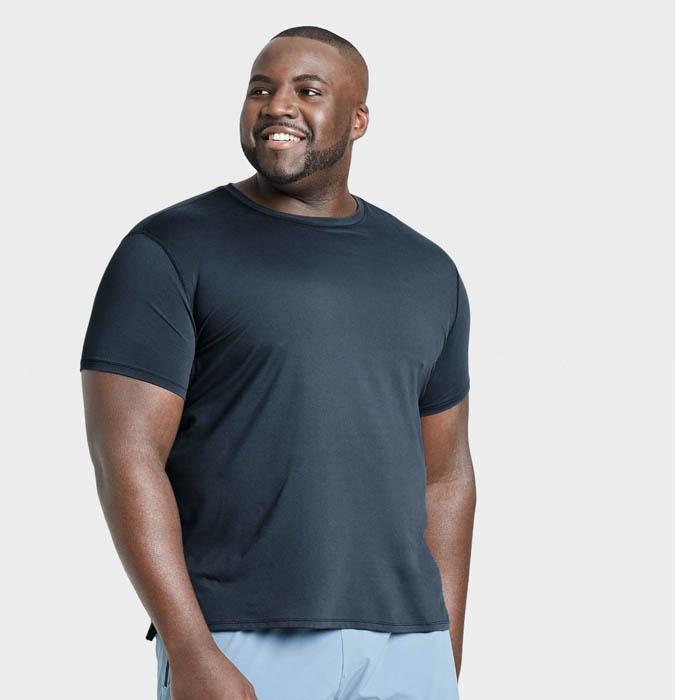 man wearing a navy blue short sleeve performance shirt