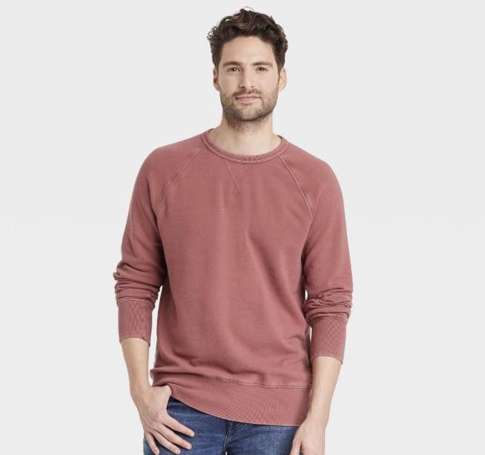 man wearing a red crewneck sweatshirt