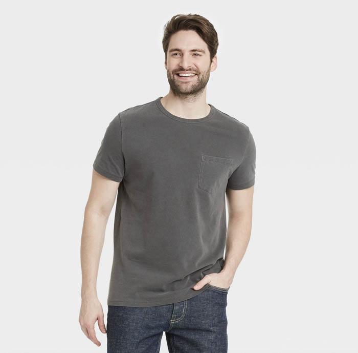 man wearing a dark grey crewneck shirt
