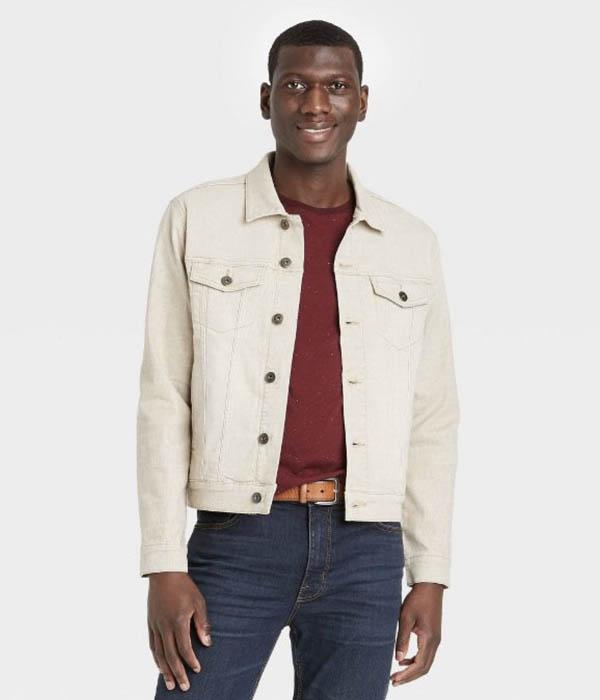 man wearing a khaki colored denim trucker jacket