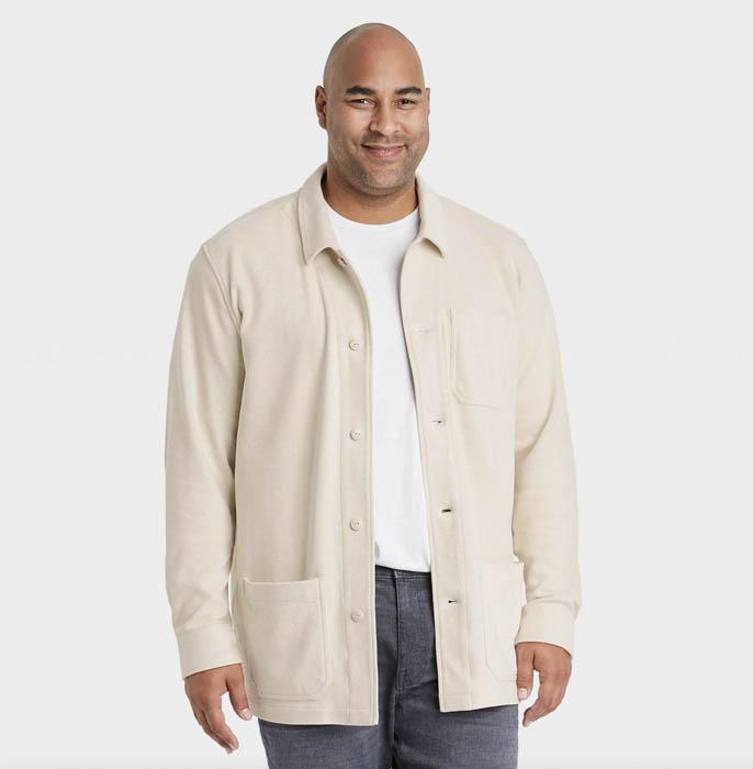 man wearing a light beige knit chore jacket