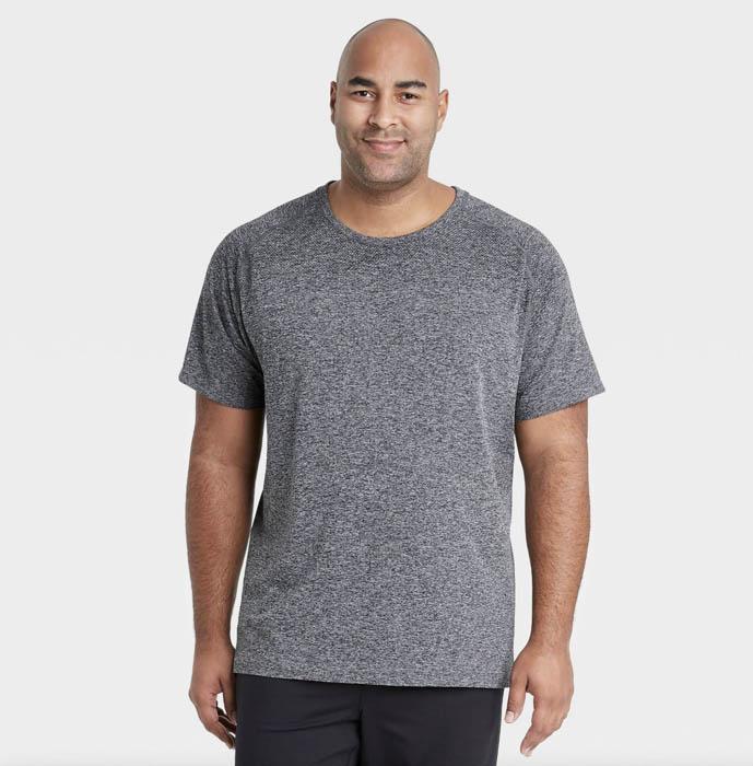 man wearing a grey short sleeve crewneck shirt