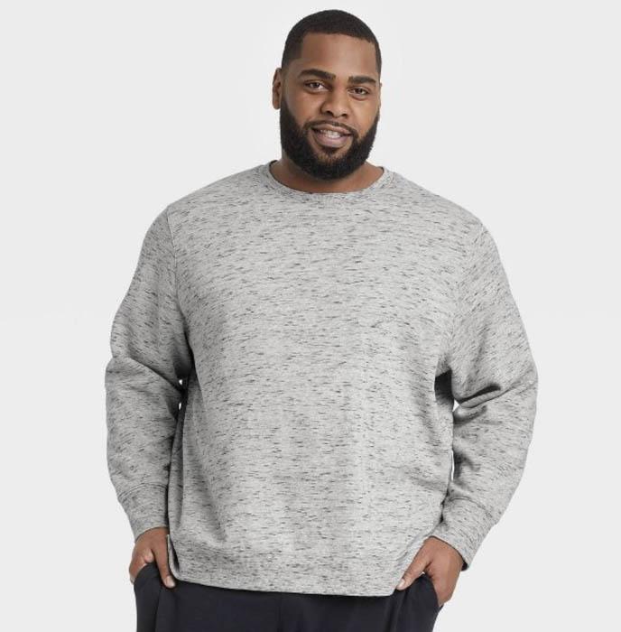 man wearing a grey fleece crewneck sweatshirt