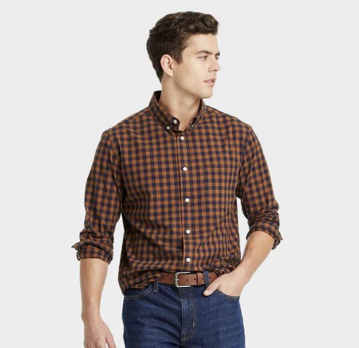 man wearing a black and gold check long sleeve button down shirt