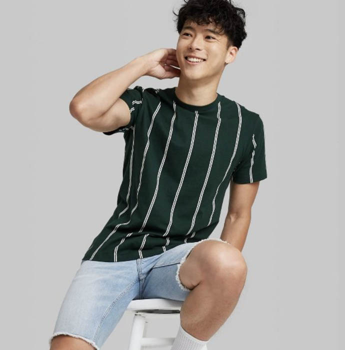 man wearing a green striped crewneck shirt