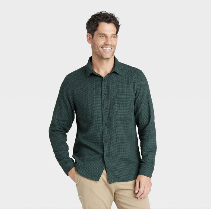 man wearing a dark green long sleeve button down shirt