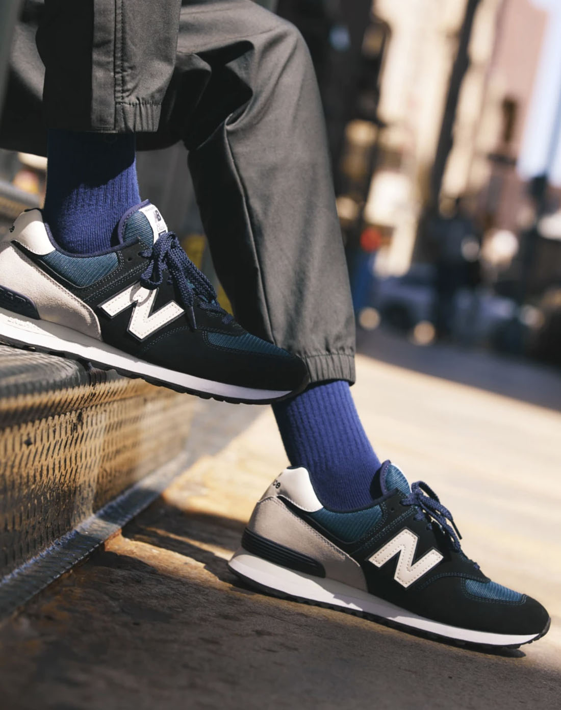 close up image of black and white nike brand shoes and blue socks